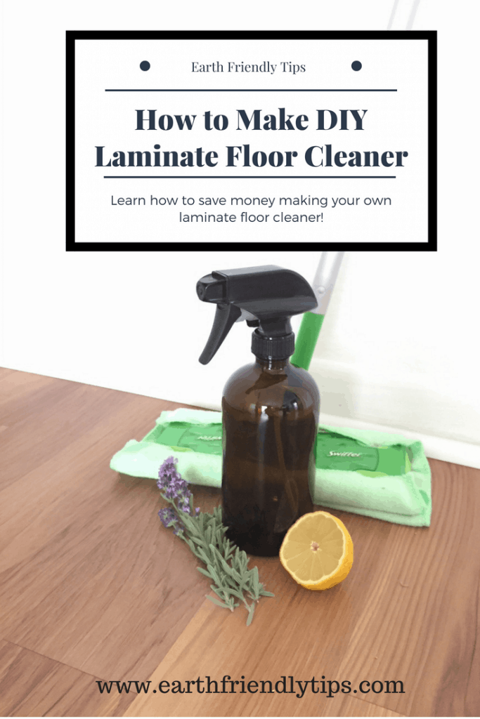 Glass spray bottle, mop, lemon wedge, and sprig of lavender on laminate wood floor