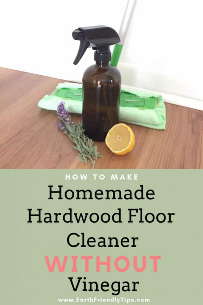 Sprig of lavender, lemon wedge, glass spray bottle, and mop on wood floor
