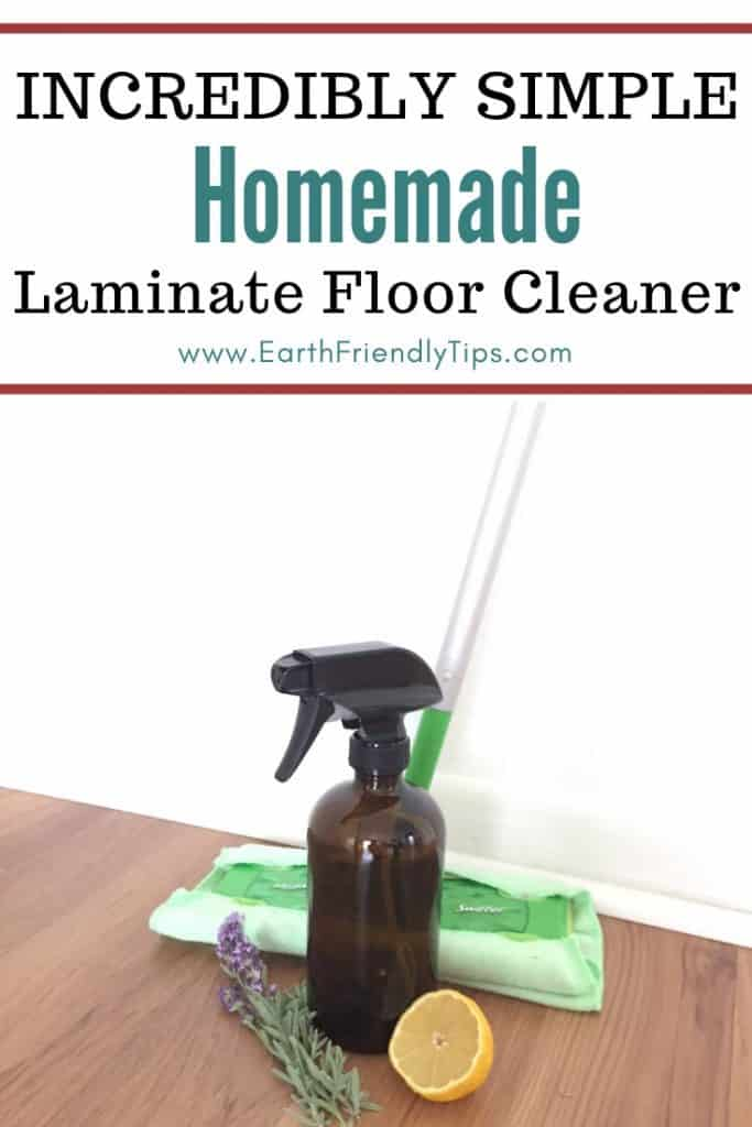 Glass spray bottle, mop, spring of lavender, and lemon wedge on laminate floor