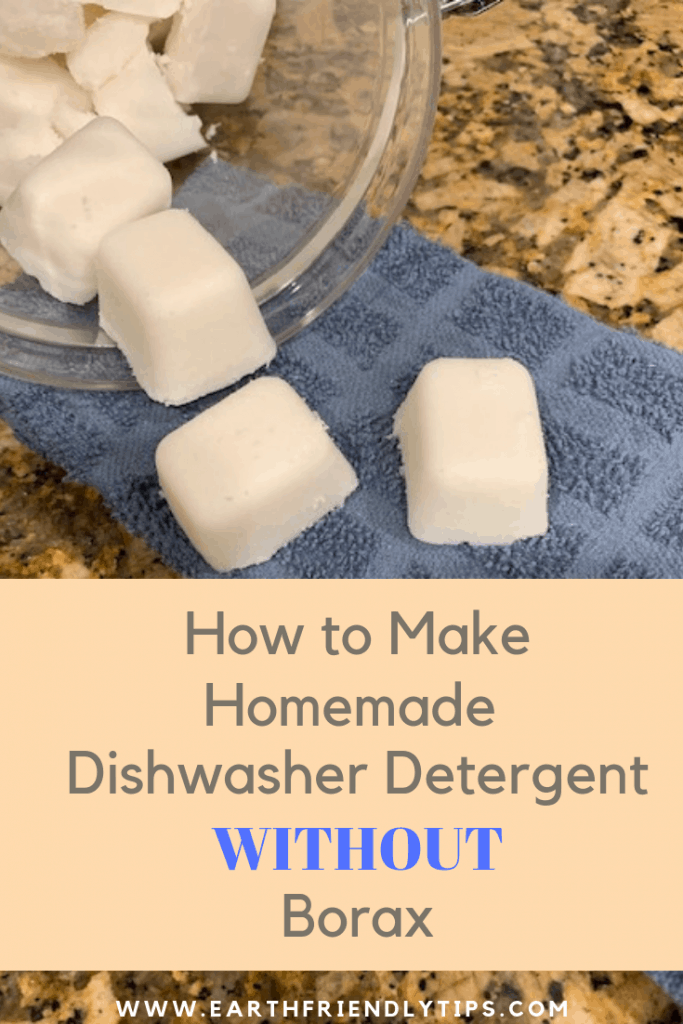 White dishwasher tablets on blue towel with text overlay How to Make Homemade Dishwasher Detergent Without Borax