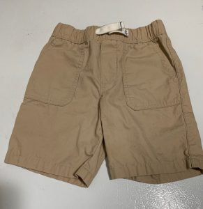 Clean khaki shorts on white background