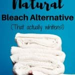 Hands holding stack of white towels text overlay How to Make Natural Bleach Alternative