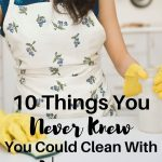 Woman with sponge and spray bottle text overlay 10 Things You Never Knew You Could Clean With Vinegar