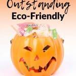 Orange plastic jack-o-lantern filled with eco-friendly Halloween treats