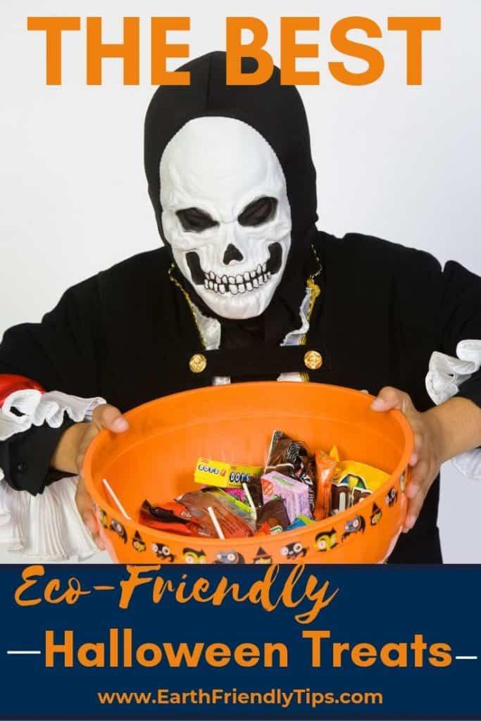 Boy wearing skeleton costume holding bowl of eco-friendly Halloween treats