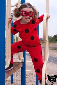 Girl in Miraculous Ladybug costume