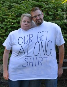 Two adults in Our Get Along Shirt costume