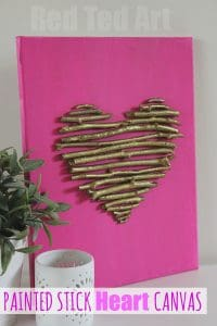 Upcycled stick heart canvas