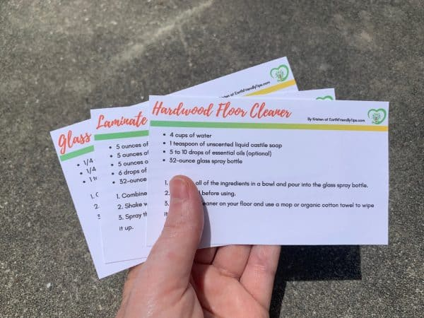 Hand holding natural cleaning recipe cards
