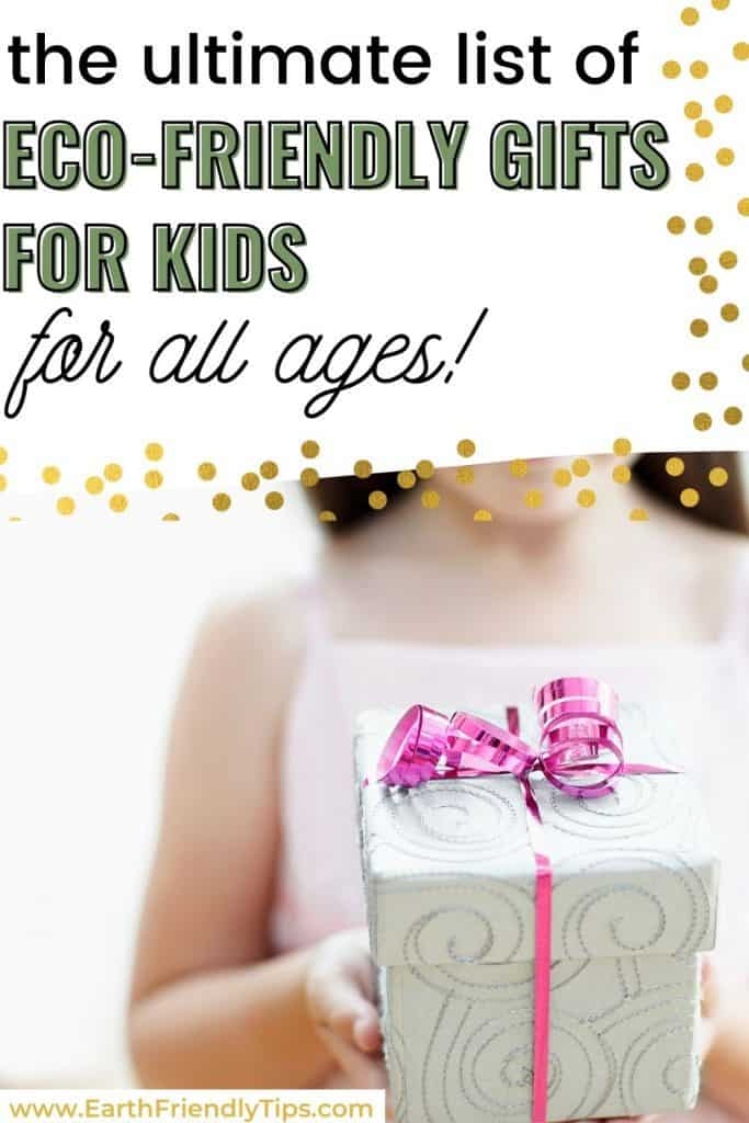 Young girl holding present text overlay The Ultimate List of Eco-Friendly Gifts for Kids